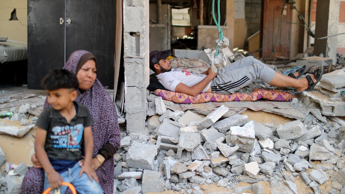 A Palestinian man rests amidst the debris after returning to his damaged house following Israel- Hamas truce, in Beit Hanoun in the northern Gaza Strip, May 21, 2021. (Reuters)