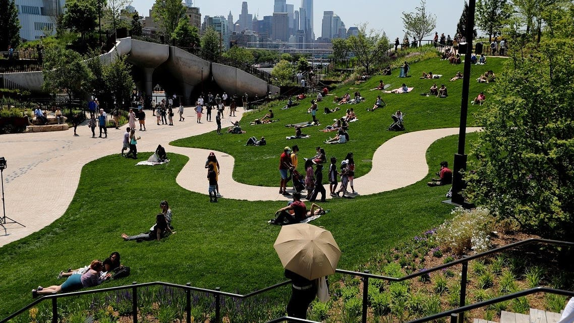 People visit Little Island Park, a new public park space which sits on stilts over the Hudson River during opening day in New York. (Reuters)