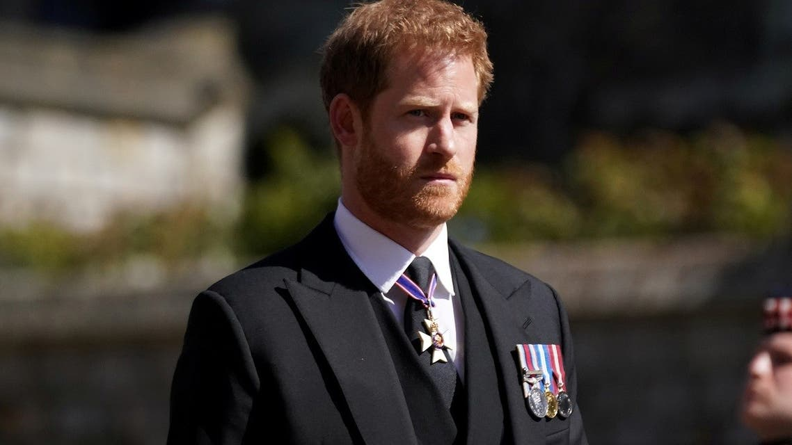 Britain's Prince Harry walking in the procession at Windsor Castle, Berkshire, during the funeral of Britain's Prince Philip, who died at the age of 99, Britain, April 17, 2021.  (Reuters)