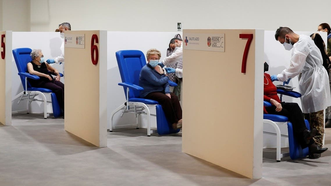 Women receive the Moderna vaccine against the coronavirus disease (COVID-19) at the Music Auditorium in Rome, Italy. (Reuters)