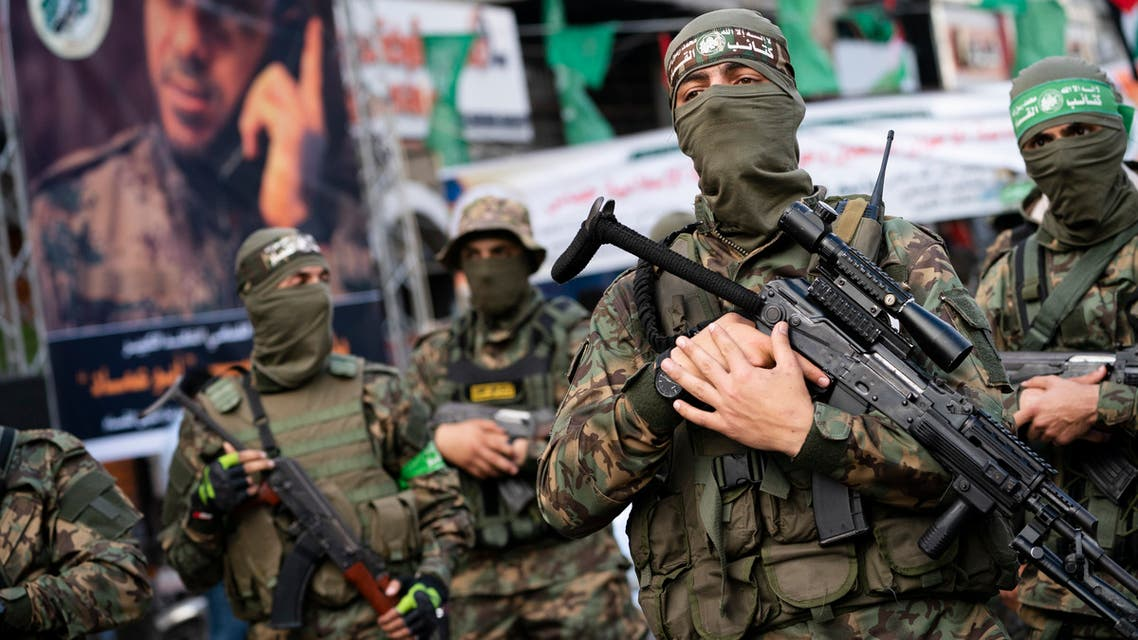 Hamas militants parade through the streets for Bassem Issa, a top Hamas' commander, who was killed by Israeli Defense Force military actions prior to a cease-fire reached after an 11-day war between Gaza's Hamas rulers and Israel, in Gaza City, Saturday, May 22, 2021. (AP)