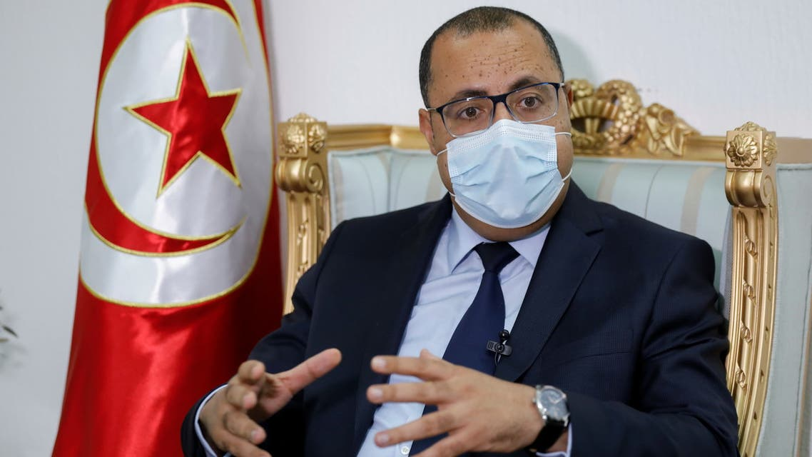 Tunisian Prime Minister Hichem Mechichi speaks during an interview with Reuters in Tunis, Tunisia April 30, 2021. (Reuters)