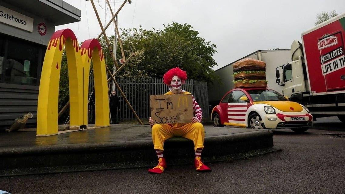 Animal Rebellion activists blockade McDonald's distribution center in Hemel Hempstead, Hertfordshire. (Reuters)