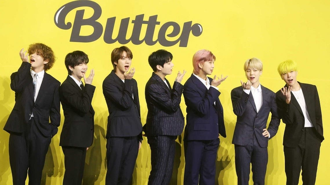 Members of South Korean K-pop boy band BTS pose for photographs during a press conference to promote their new single album 'Butter' in Seoul on May 21, 2021. (AFP)