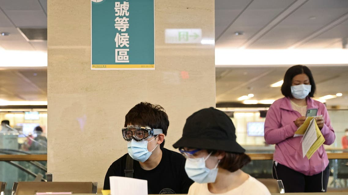 People wearing protective gear sit at a waiting area during a vaccination session for healthcare workers following the recent rise in coronavirus disease (COVID-19) infections, at Far Eastern Memorial Hospital in New Taipei City, Taiwan May 20, 2021. REUTERS/Ann Wang