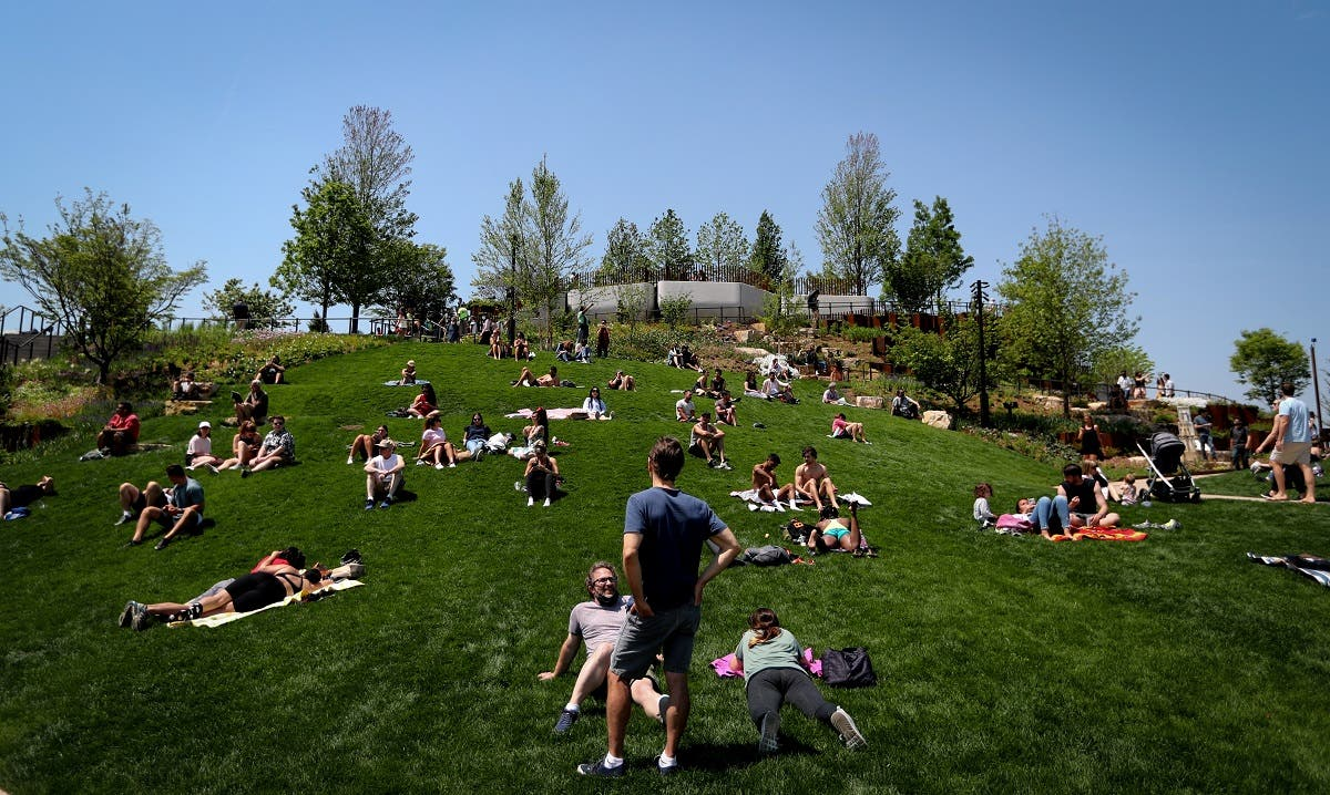 People visit Little Island Park, almost three acres of new public park space which sits on stilts over the Hudson River and the remnants of Pier 54 in the larger Hudson River Park, on Manhattan's West Side, during the park's opening day in New York City, New York, U.S., May 21, 2021. (Reuters)