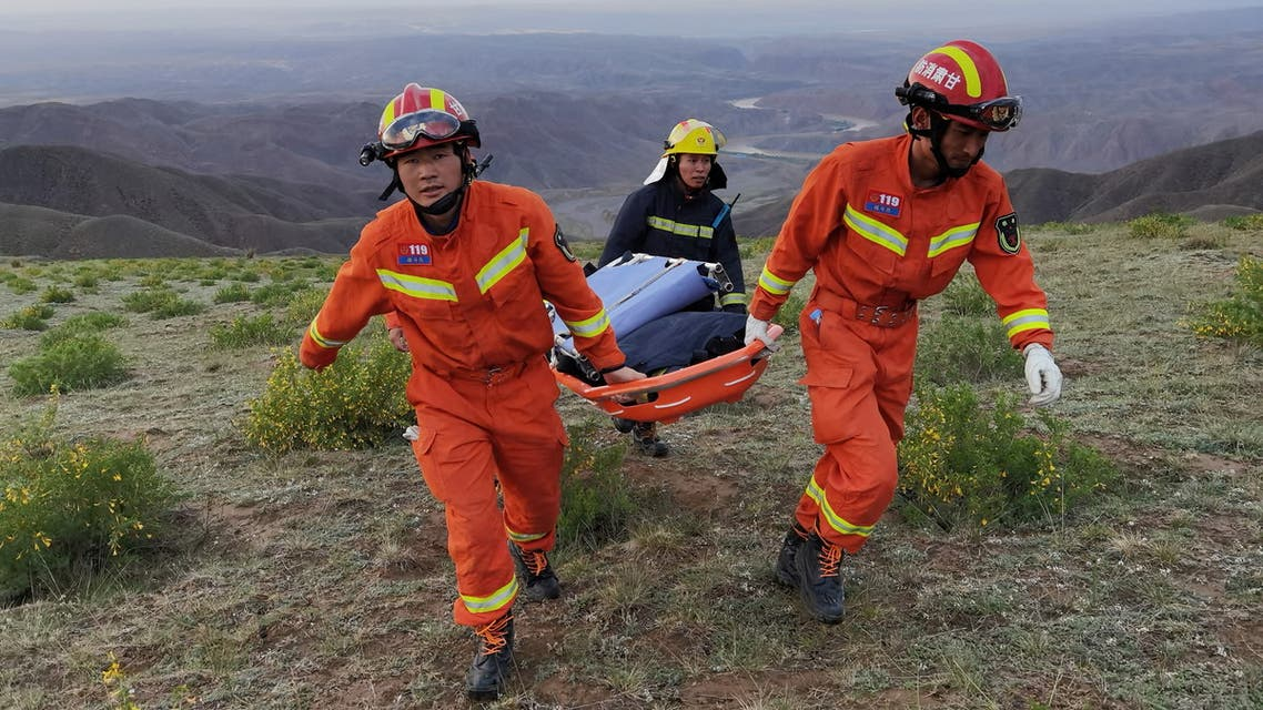 Rescue workers carry a stretcher as they work at the site where extreme cold weather killed participants of an 100-km ultramarathon race in Baiyin, Gansu province, China May 22, 2021. (Reuters)
