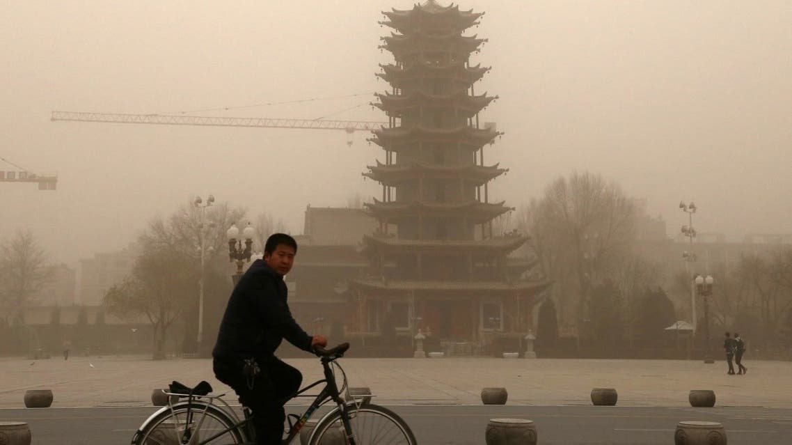 This photo taken on November 25, 2018 shows a cyclist riding in a sandstorm in Zhangye, in China's northwestern Gansu province. (AFP)