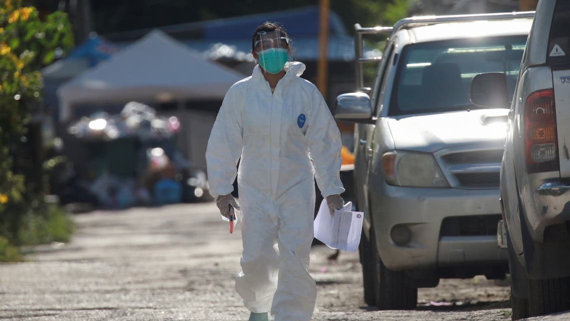 A healthcare worker walks near a workers' dormitory where more than a thousand COVID-19 cases were detected, in Bangkok, Thailand May 22, 2021. (Reuters)
