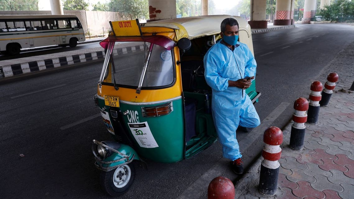 Raj Kumar, 42, a driver of an auto rickshaw ambulance which is prepared to transfer people suffering from the coronavirus disease (COVID-19) and their relatives for free, waits for passengers in New Delhi, India May 6, 2021. (Reuters)