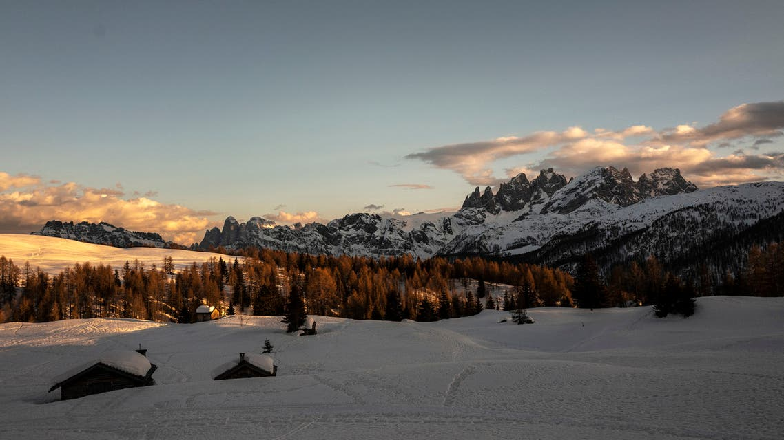 The sun sets in Passo San Pellegrino in the Alps' village of Moena, Northeastern Italy. (File photo: AFP)