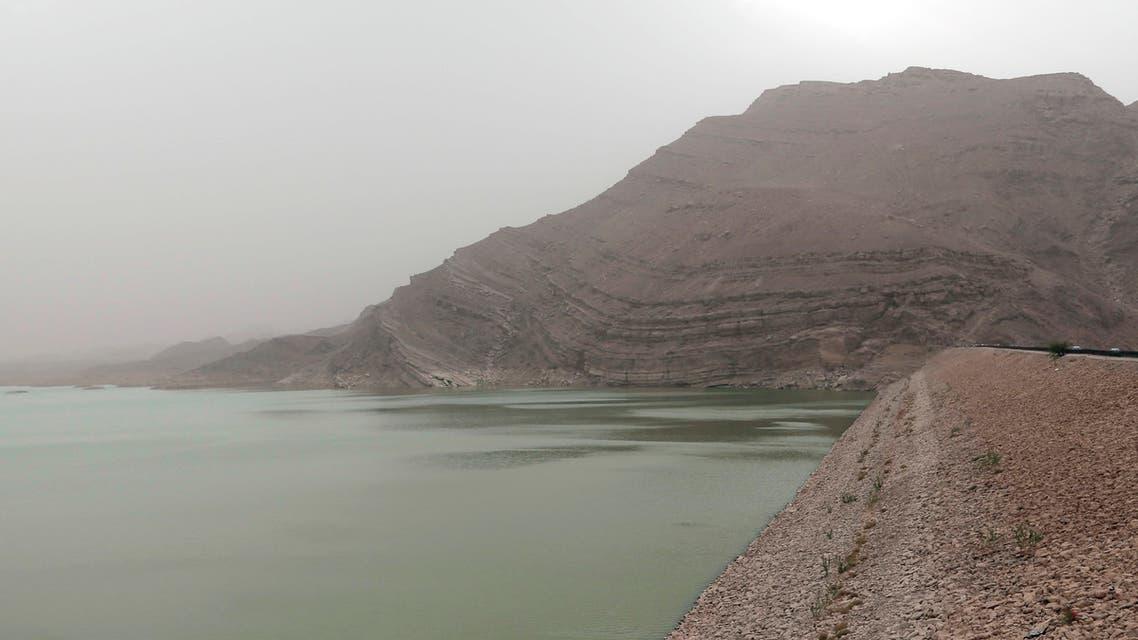 Women stand near the water's edge at the Marib Dam in Yemen on July 30, 2018. (AP)