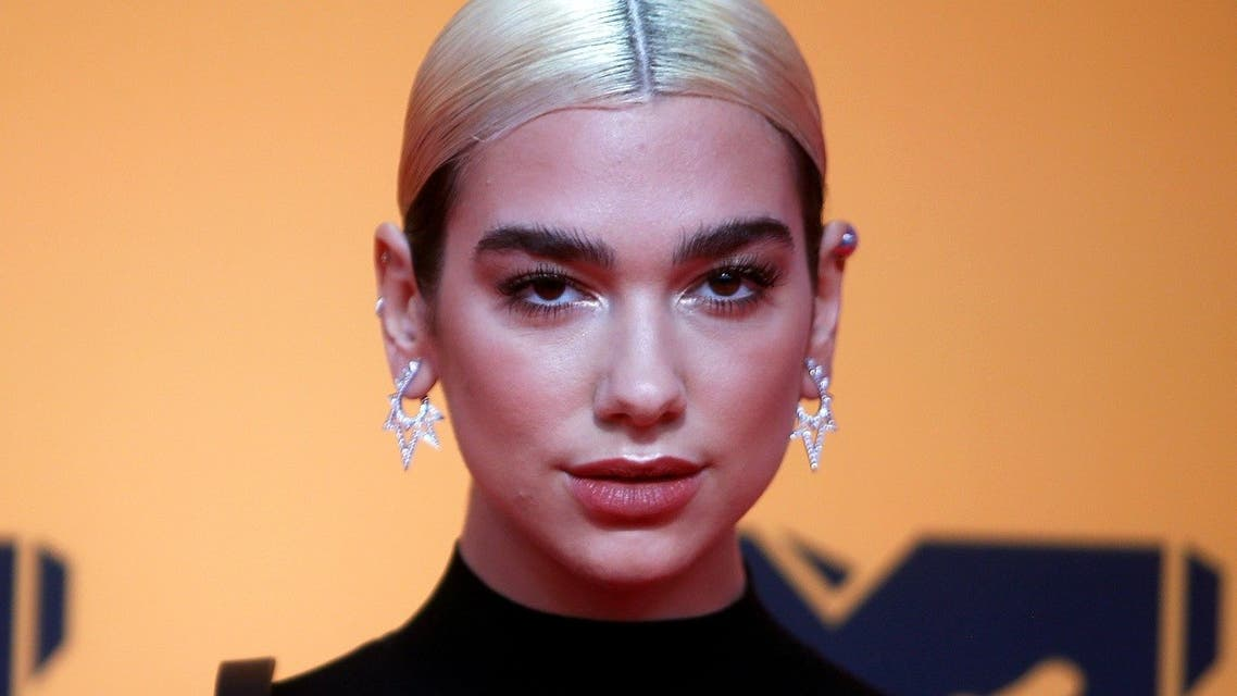 Dua Lipa poses on a red carpet as she arrives at the 2019 MTV Europe Music Awards at the FIBES Conference and Exhibition Centre in Seville, Spain. (Reuters)