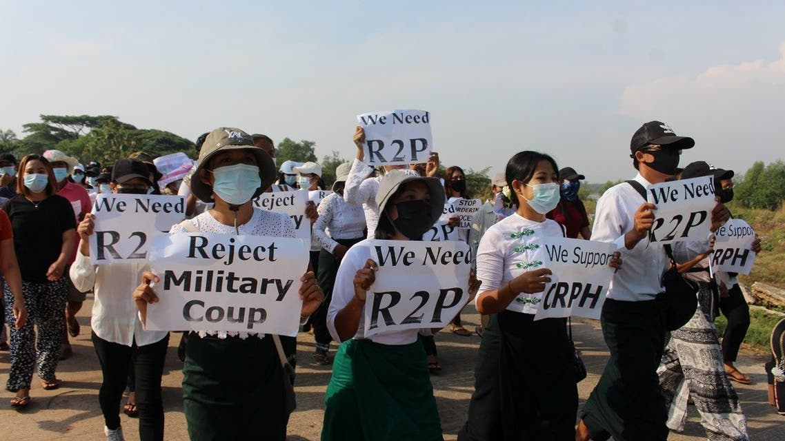 Demonstrators carry placards as university students, engineers and teachers along with others march during a protest against the military coup in Dawei, Myanmar April 4, 2021. (Reuters)