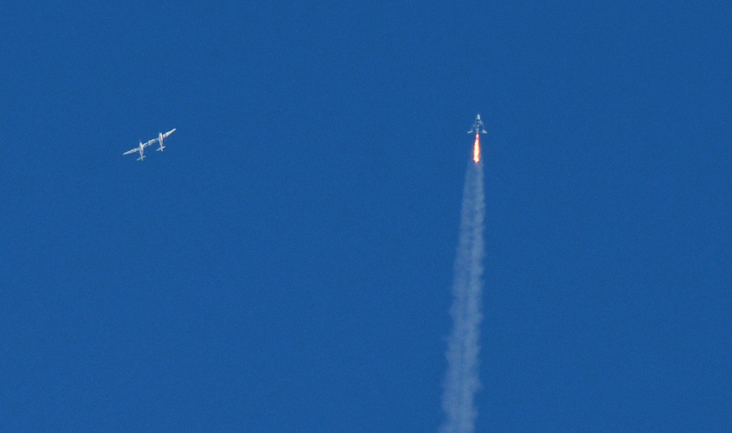The SpaceShipTwo VSS Unity passenger craft (R) is seen after separation from Virgin Galactic rocket plane, the WhiteKnightTwo carrier airplane (L), upon taking off from Mojave Air and Space Port in Mojave, California, US, February 22, 2019. (Reuters)