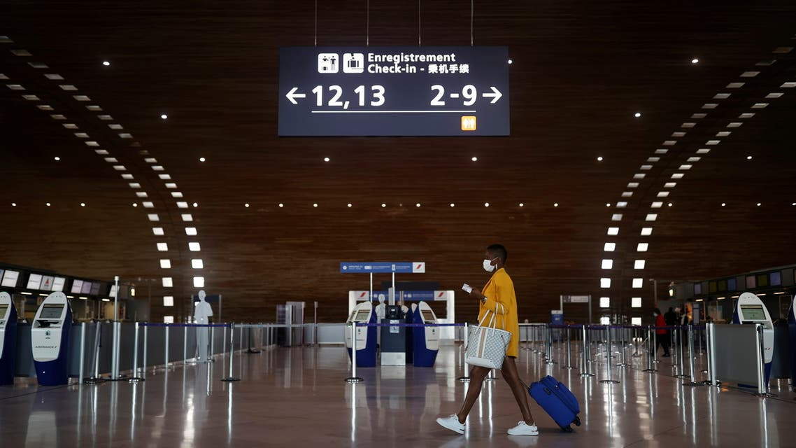 A woman makes her way in the departures area of the Terminal 2E at Charles-de-Gaulle airport amid the coronavirus disease (COVID-19) outbreak, in Roissy, near Paris, France April 2, 2021. (Reuters)
