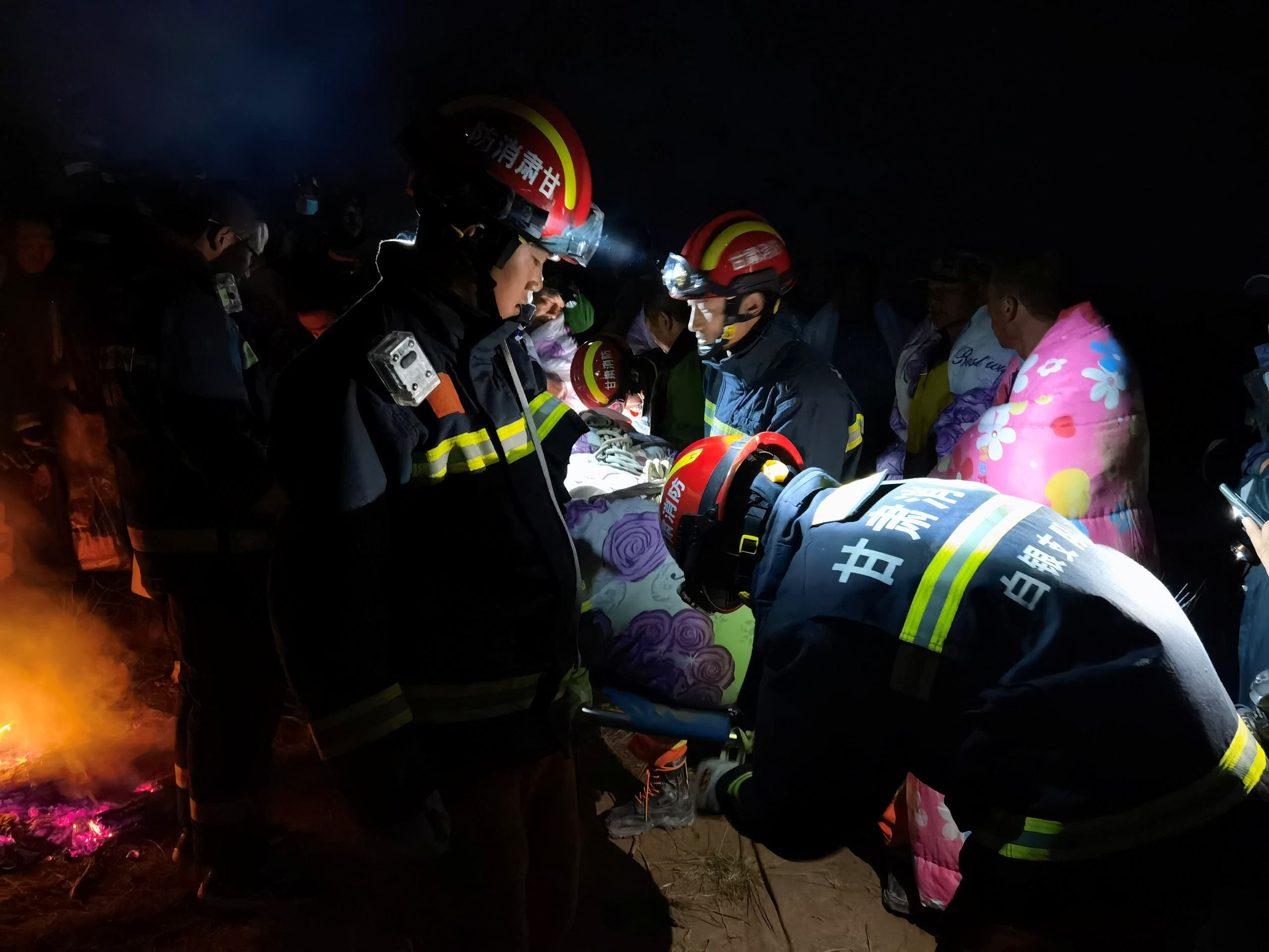 Rescue workers work at the site where extreme cold weather killed participants of an 100-km ultramarathon race in Baiyin, Gansu province, China May 22, 2021. (Reuters)