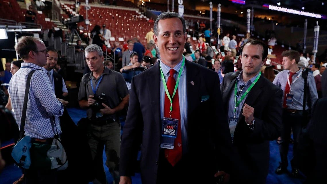 A file photo shows senator Rick Santorum (R-PA) walks the floor before the start of the first day of the Democratic National Convention in Philadelphia, Pennsylvania, US July 25, 2016. (Reuters/Mark Kauzlarich)