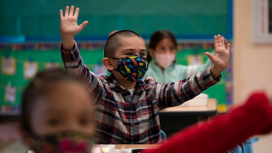 Kindergarten students participate in a classroom activity on the first day of in-person learning at Maurice Sendak Elementary School in Los Angeles, April 13, 2021. (AP)