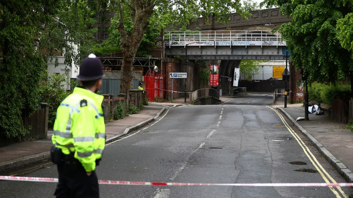A police officer guards the area after Sasha Johnson, a BLM activist, was shot in an early morning attack near her home in Peckham, London, Britain, May 24, 2021. (Reuters)