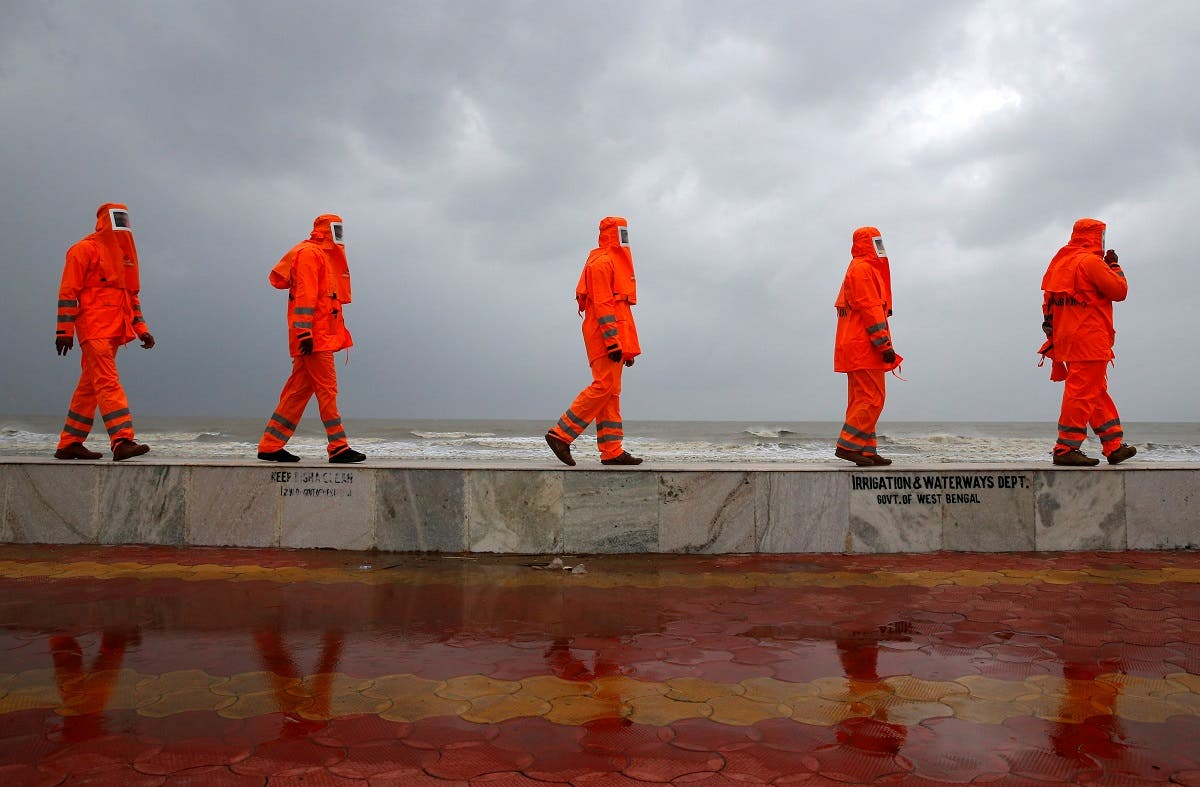 Members of the National Disaster Response Force (NDRF) patrol along a shore ahead of Cyclone Yaas in Digha in Purba Medinipur district in the eastern state of West Bengal, India, May 25, 2021. (Reuters)