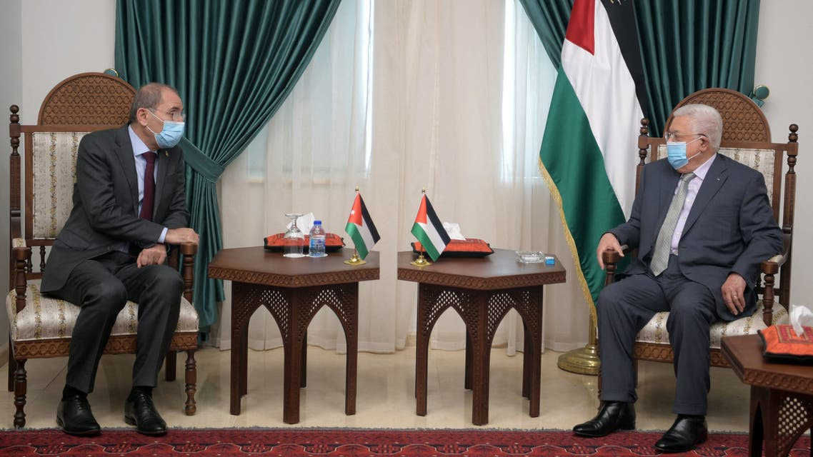 A handout picture provided by the Palestinian Authority's press office (PPO) shows Palestinian president Mahmud Abbas (R) meeting with Jordanian Foreign Minister Ayman Safadi in Ramallah in the occupied West Bank on May 25, 2021.