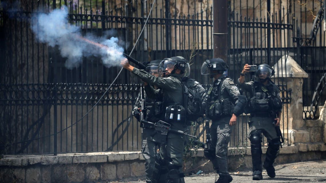 A member of Israeli border police fires tear gas canisters to disperse Palestinian demonstrators during an anti-Israel protest, in Bethlehem in the Israeli-occupied West Bank May 21, 2021. (Reuters)