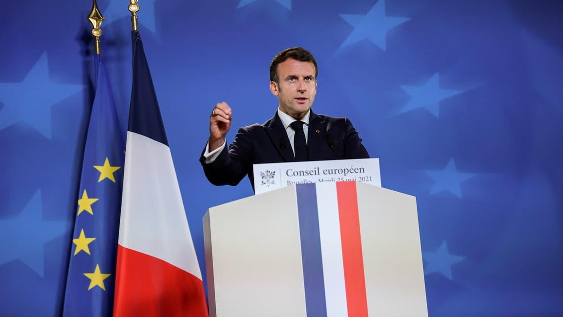 French President Emmanuel Macron gestures as he addresses media representatives at a press conference on the second day of an EU summit at the European Council building in Brussels, Belgium, May 25, 2021. John Thys/Pool via REUTERS