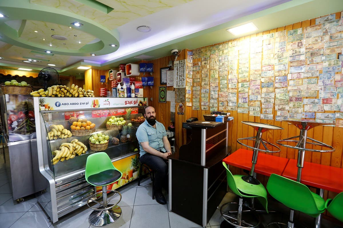 Ahmed, a 40-year old Syrian man from Damascus, selling fruit juice is pictured at his shop in Istanbul, Turkey May 24, 2021. (Reuters)