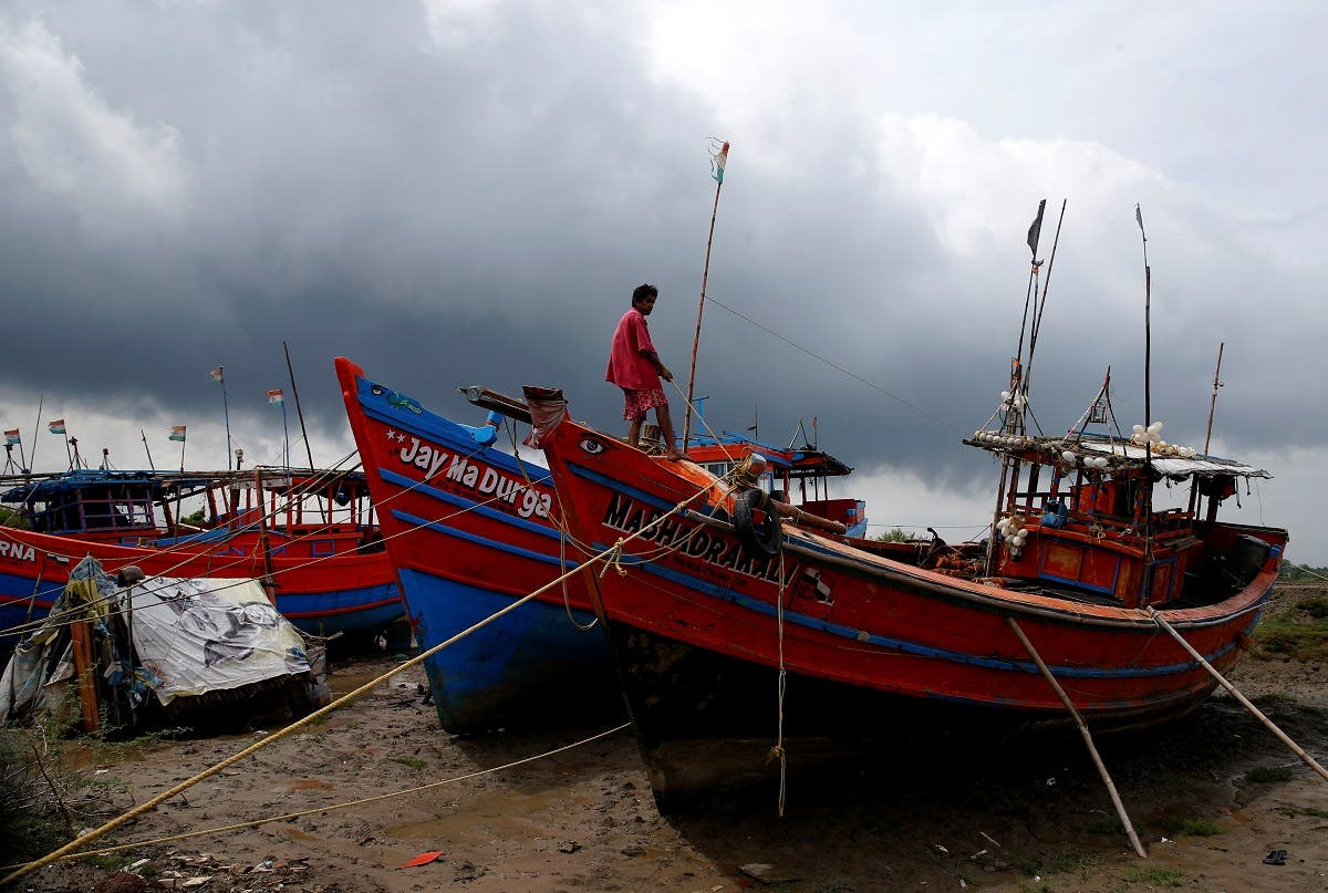 A fisherman ties his boat on a shore ahead of Cyclone Yaas in Digha in Purba Medinipur district in the eastern state of West Bengal, India, on May 25, 2021. (Reuters)