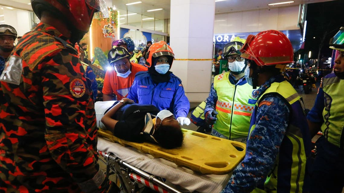 This picture taken on May 24, 2021 shows rescue personnel tending to an injured passenger ooutside KLCC station after an accident involving two Light Rail Transit (LRT) trains in Kuala Lumpur. More than 200 passengers were injured in the Malaysian capital on May 24 when two metro trains collided in a tunnel, police said. (File photo: AFP)