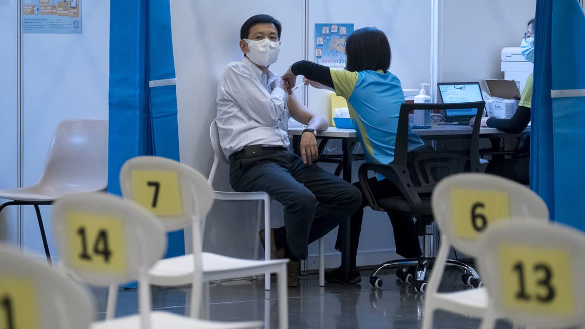 A man receives a dose of China's Sinovac COVID-19 coronavirus vaccine at a community vaccination centre in Hong Kong on February 23, 2021.