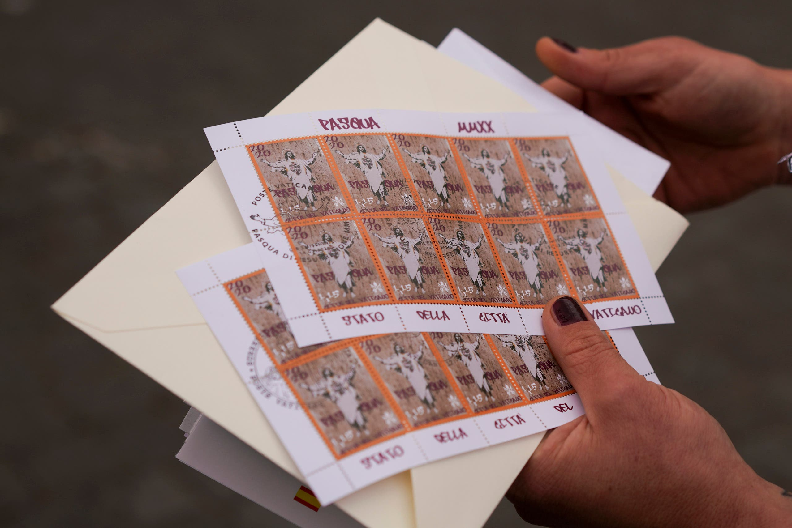 Artist Alessia Babrow shows the Vatican stamps during an interview with the Associated Press, at the Vatican, Friday, May 14, 2021. (AP)