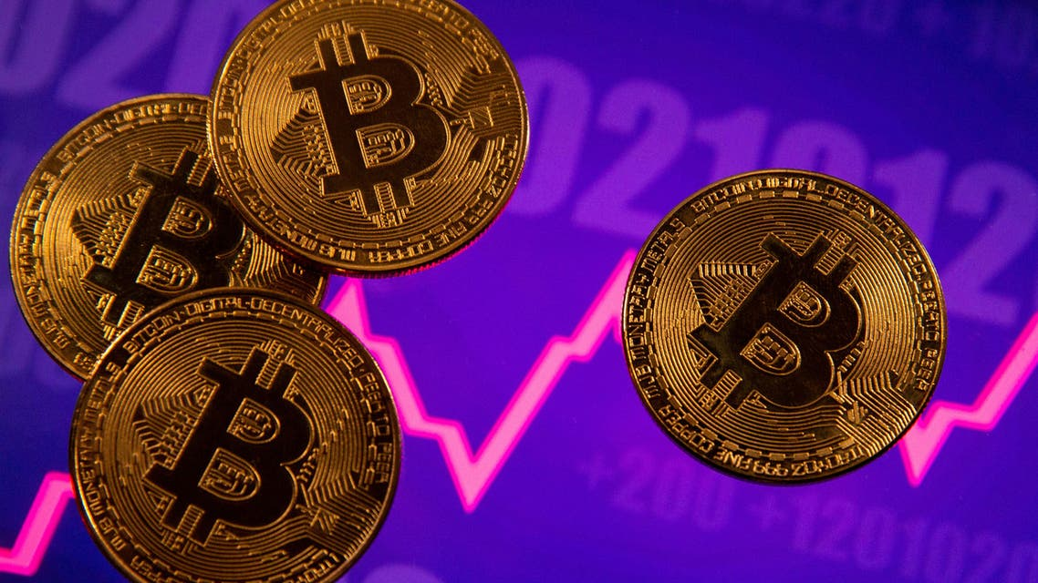 FILE PHOTO: A representation of virtual currency Bitcoin is seen in front of a stock graph in this illustration taken March 15, 2021. (File Photo: Reuters)