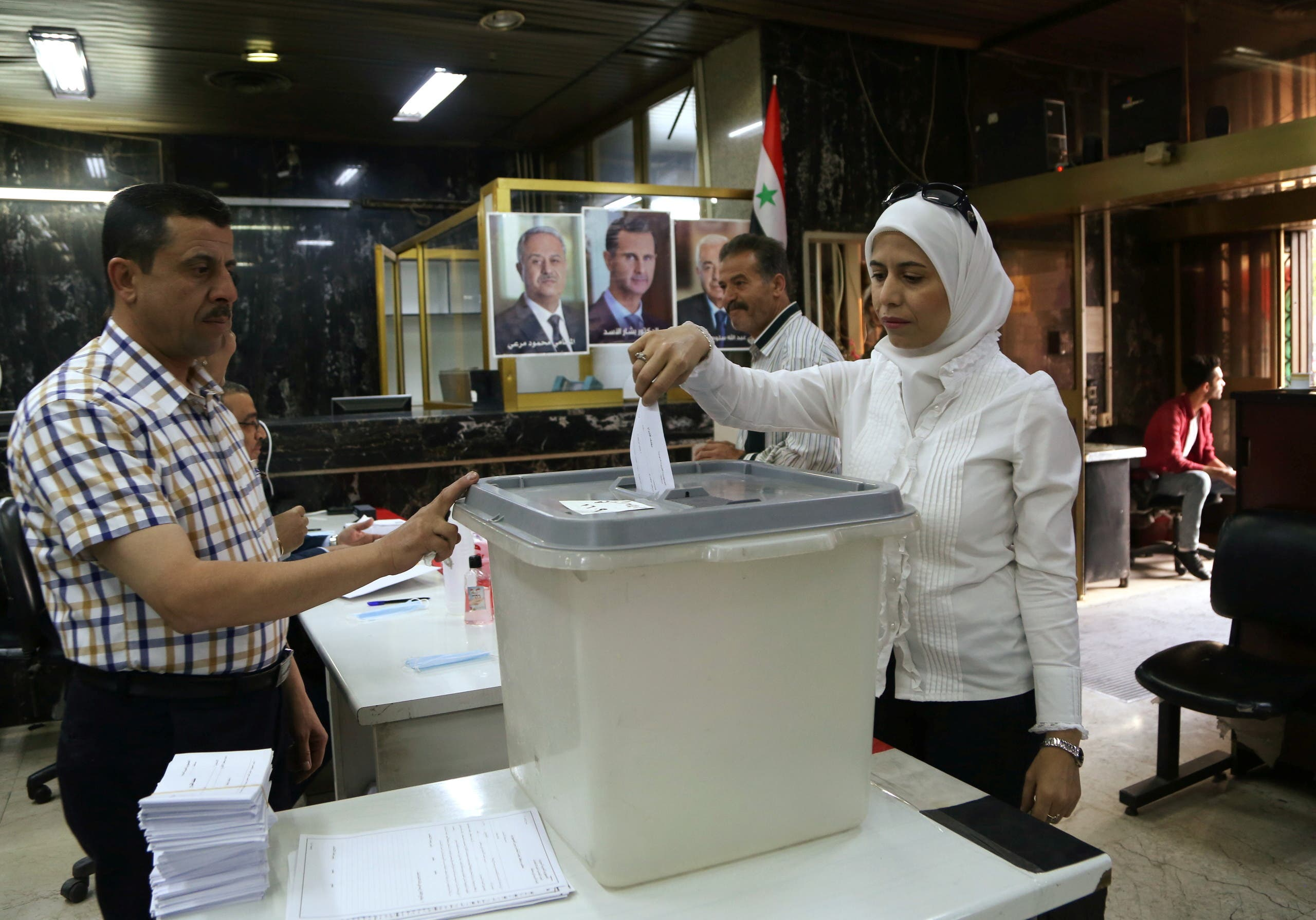 A woman casts her vote at a polling station during the presidential elections in Damascus. (Reuters)