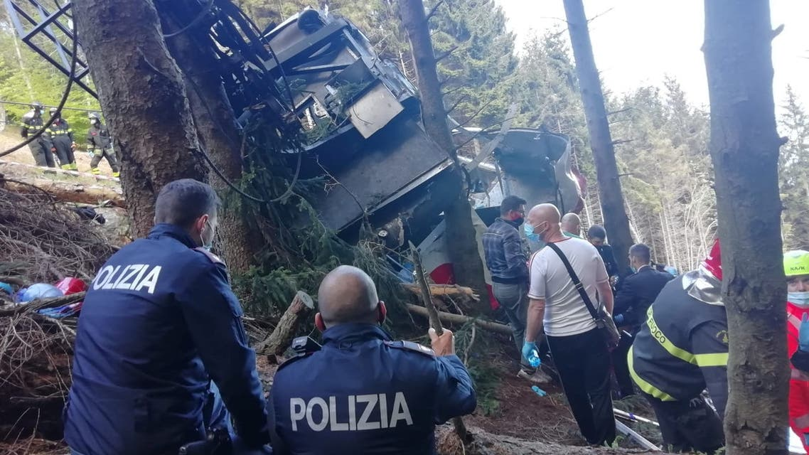 Police and rescue service members are seen near the crashed cable car after it collapsed in Stresa, near Lake Maggiore, Italy May 23, 2021. (Reuters)