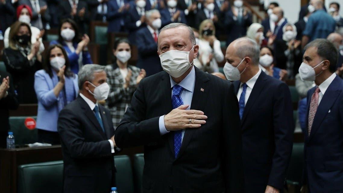 Turkey's President Erdogan greets members of his ruling AK Party during a meeting at the parliament in Ankara, Turkey May 26, 2021. (Murat Cetinmuhurdar/Presidential Press Office/Handout via Reuters)