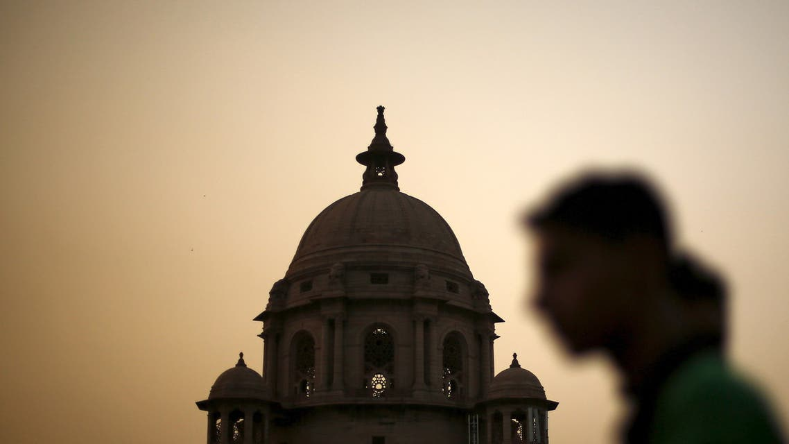 A commuter walks past the building of India's Ministry of Finance during dusk in New Delhi, India, May 18, 2015. India's Finance Ministry could have sidestepped a damaging multibillion-dollar tax row with foreign investors if it had acted on regular warning letters that officials had been sending since as long ago as September. (Reuters)