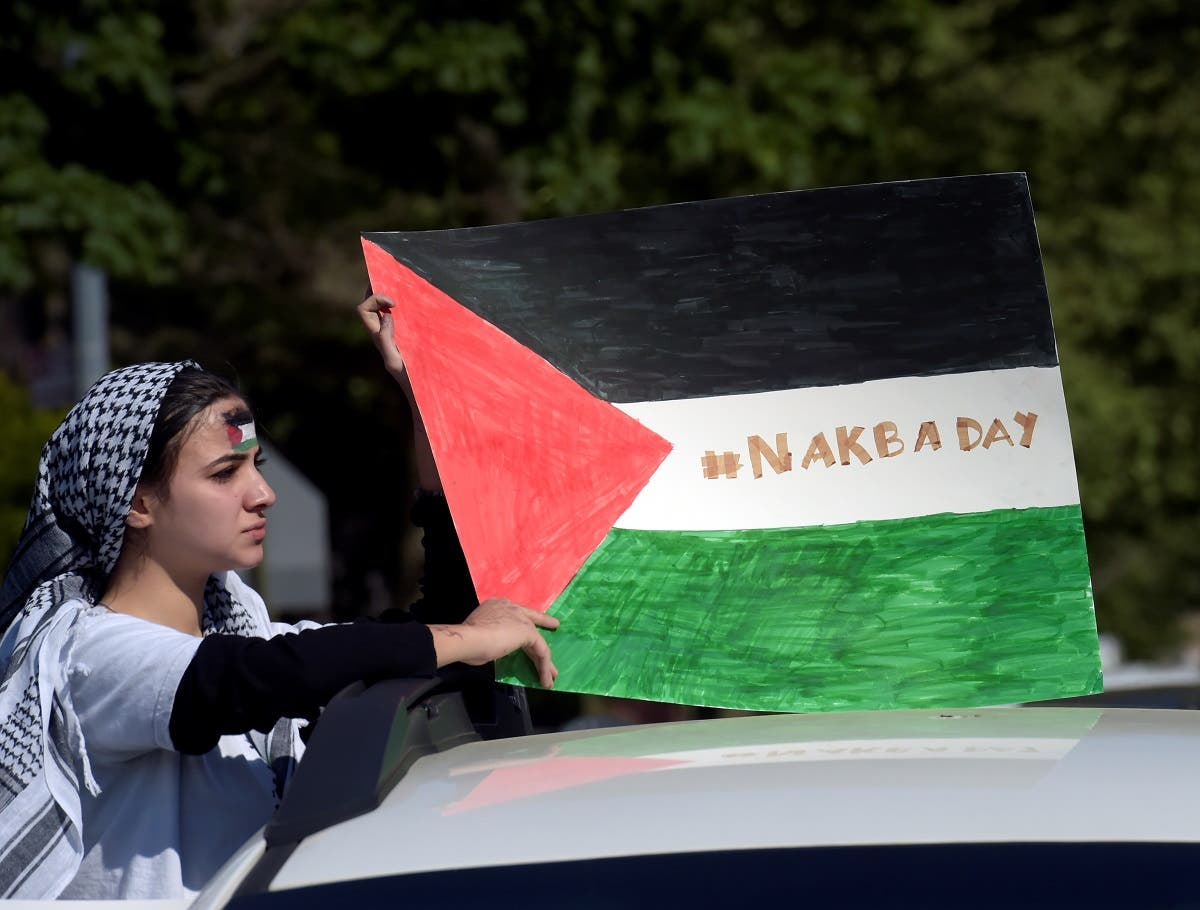 A pro-Palestinian supporter holds a Palestine flag during a protest against Israeli attacks on Gaza amid days of conflict between the two sides, in Brooklyn. (File photo: Reuters)