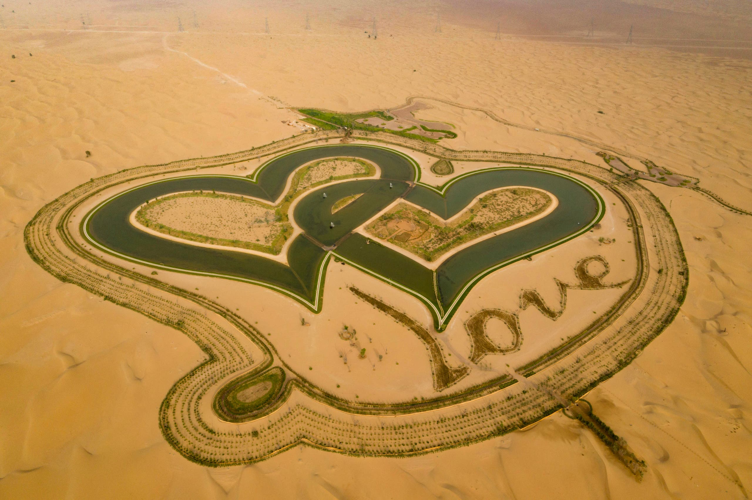 A picture taken with a drone on July 31, 2019, shows the new man-made Love lake at al-Qudra desert in the Gulf emirate of Dubai. (AFP)