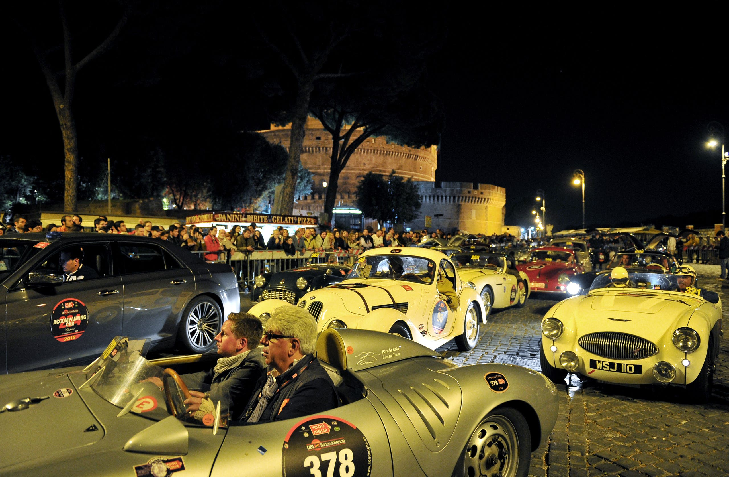 Vintage cars pass by Castel Sant'Angelo during Mille Miglia race arrival in Rome on May 18, 2012. This historic parade of classic machines called Mille miglia started in 1927 from Brescia to Rome and back. (File photo: AFP)