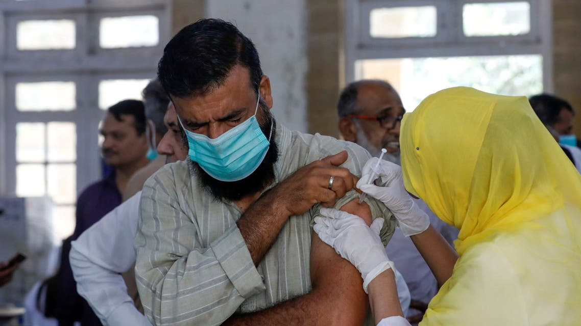 A man receives a dose of a coronavirus disease (COVID-19) vaccine, at a vaccination center in Karachi, Pakistan. (Reuters)