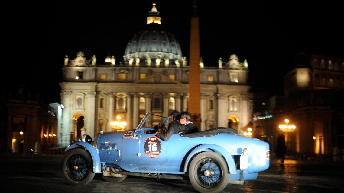A vintage racing car passes by St. Peter's square as the historic Mille Miglia race arrives in Rome on May 15, 2009. The first open-road endurance race started in 1927 from Brescia to Rome and back, a figure-eight shaped course of roughly 1500 km - or a thousand Roman miles. This parade of classic machines has earned the Mille Miglia the reputation of being the the most beautiful road race in the world. (File photo: AFP)