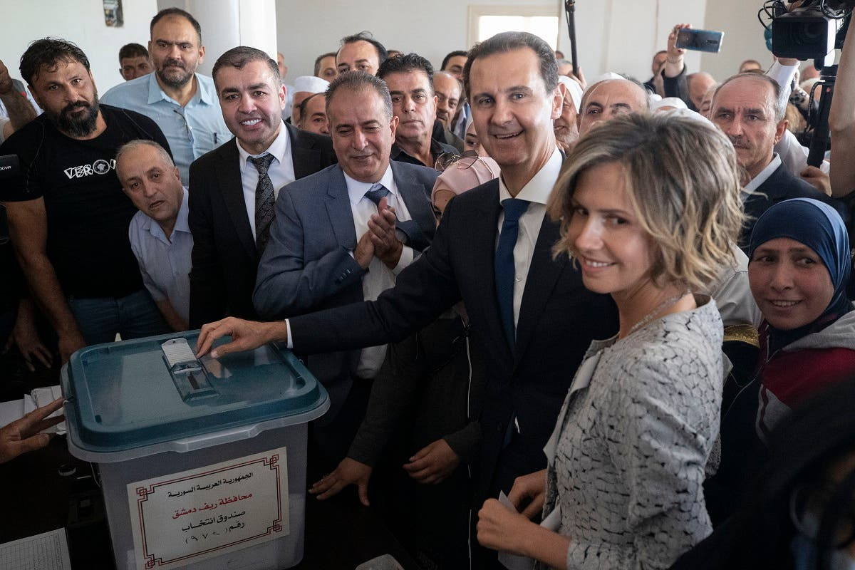 Syrian President Bashar Assad and his wife Asma vote at a polling station during the Presidential elections in the town of Douma, near the Syrian capital Damascus, Syria, May 26, 2021. (AP)
