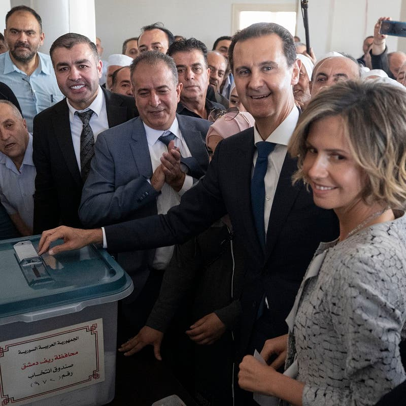 Syria's Assad votes in Douma, site of suspected chemical attack