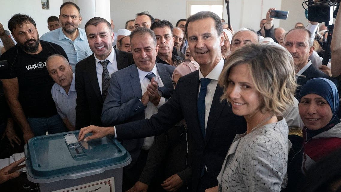 Syrian President Bashar Assad and his wife Asma vote at a polling station during the Presidential elections in the town of Douma, near the Syrian capital Damascus, Syria, May 26, 2021. (AP/Hassan Ammar)