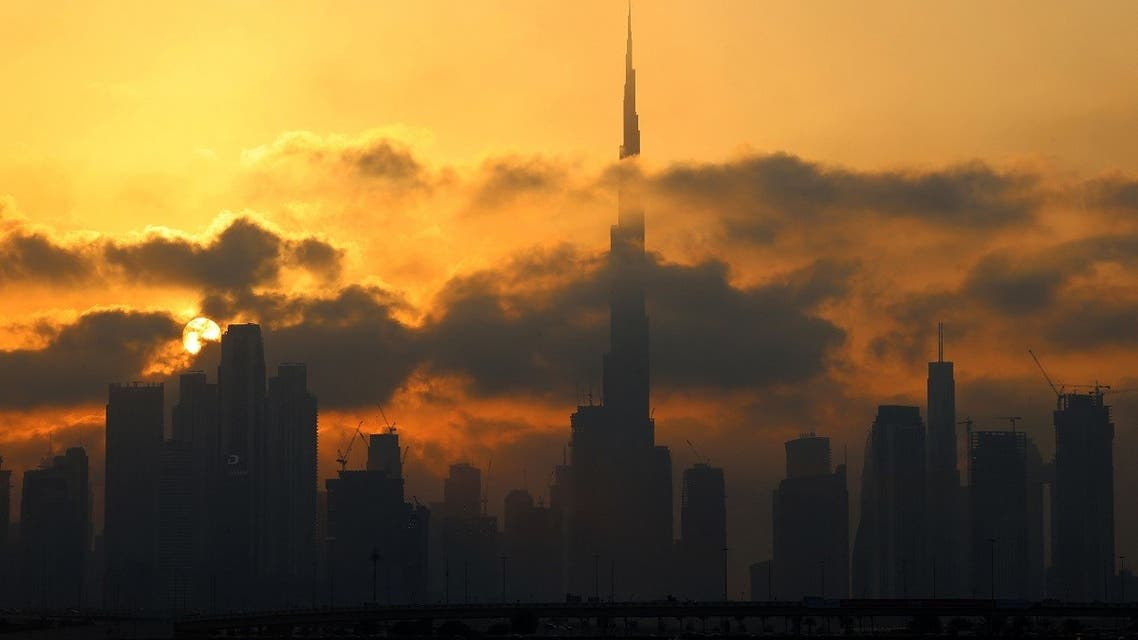 This picture taken on February 13, 2021 shows a view of the skyline of downtown Dubai with Burj Khalifa, at sunset. (AFP)