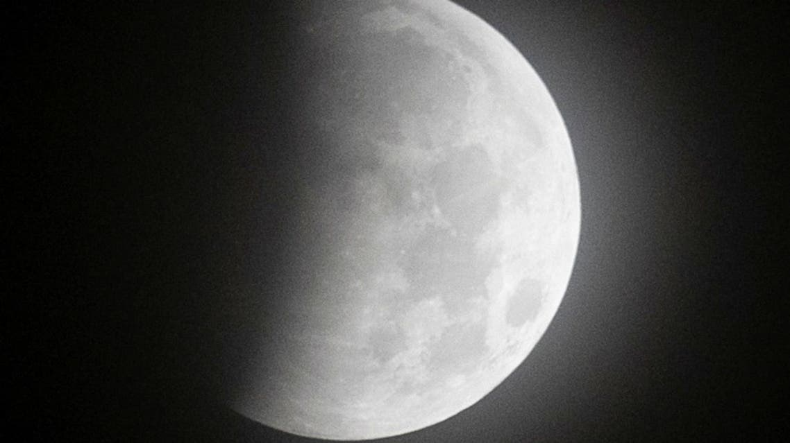 The full moon, known as Super Blood Moon, rises during a lunar eclipse in Mexico City, Mexico May 26, 2021. (Reuters)