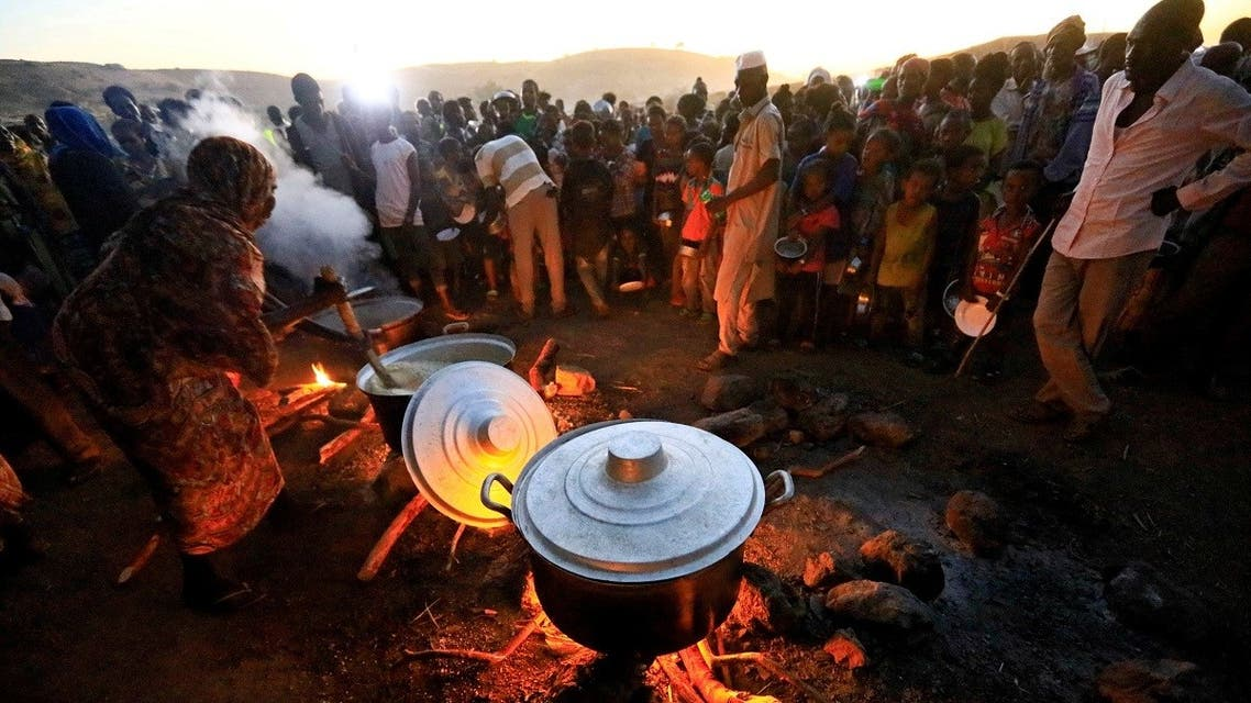 Ethiopian refugees fleeing from the fighting in Tigray region, wait for food at the Um Rakoba camp, on the Sudan-Ethiopia border, in al-Qadarif state. (File photo: Reuters)