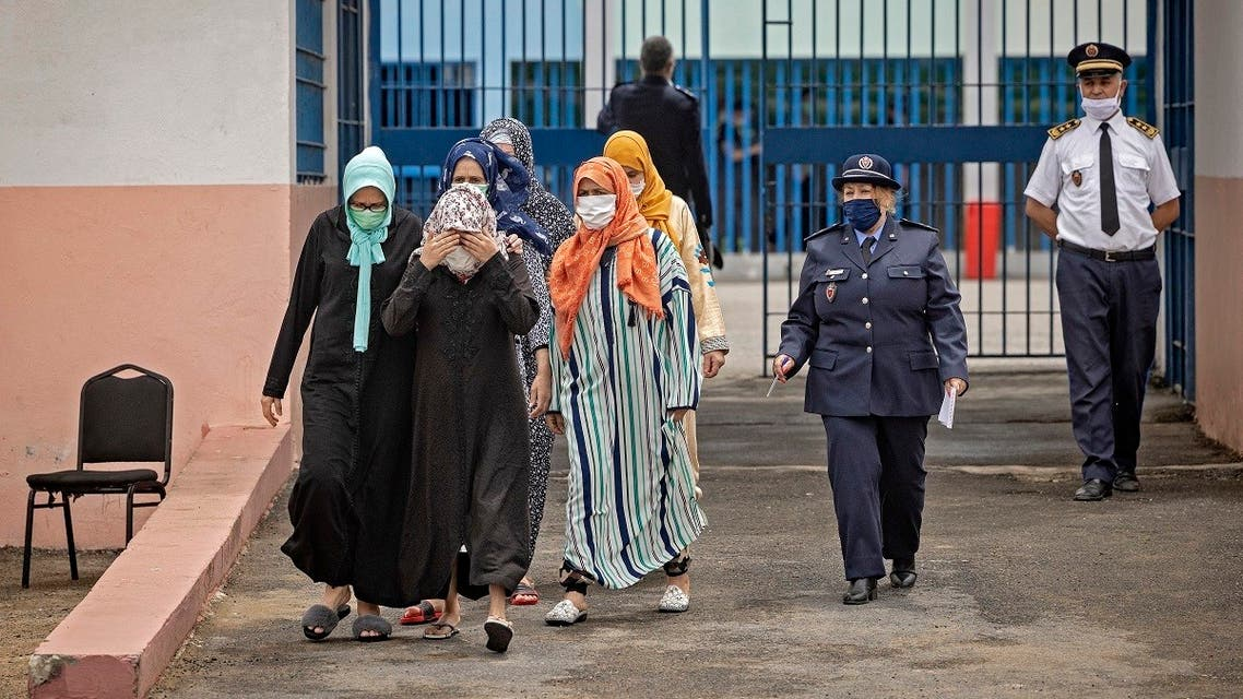 Women prisoners are escorted to receive their dose of the AstraZeneca jab against the coronavirus, during a vaccination campaign at the El-Arjate prison near the capital Rabat on, May 26, 2021. (Fadel Senna/AFP)